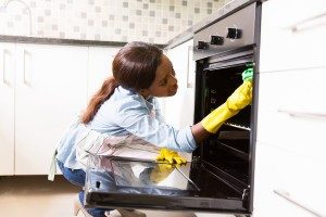 woman-cleaning-stove-300x200
